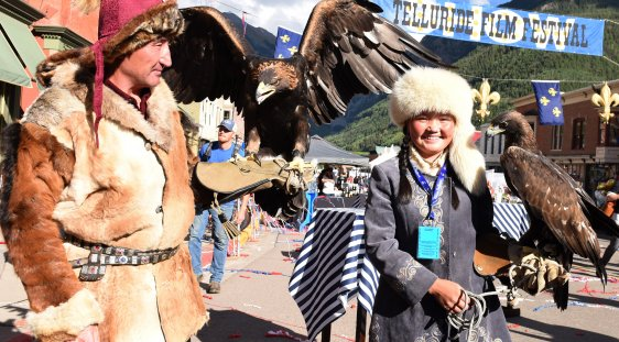 The Eagle Huntress, Aisholpan, with her father at the Opening Night Feed